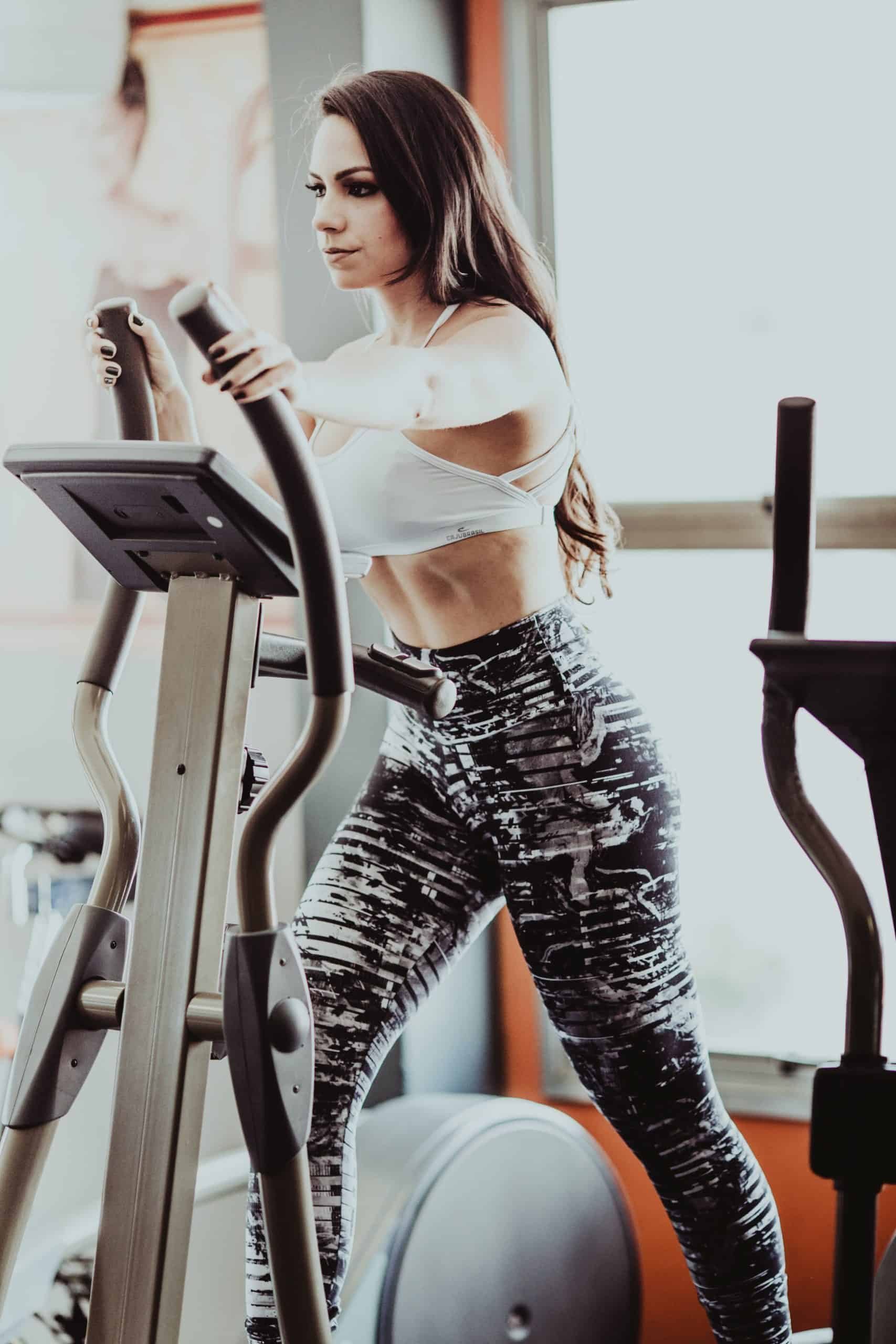 how to build muscle: a picture of a woman on an eliptical
